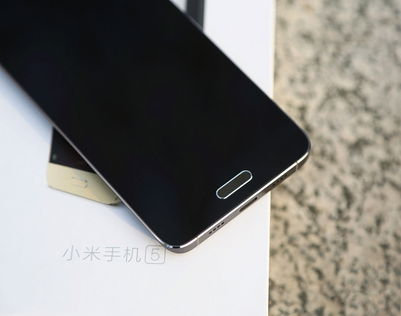Xiaomi Mi 5 smartphone placed on top of its packaging