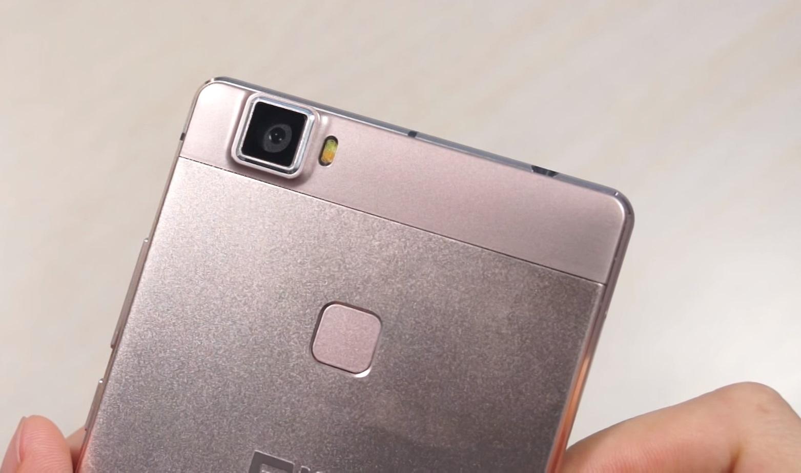 Elephone M3 Rose Gold held in hand, camera and fingerprint scanner zoomed, rose gold color option.