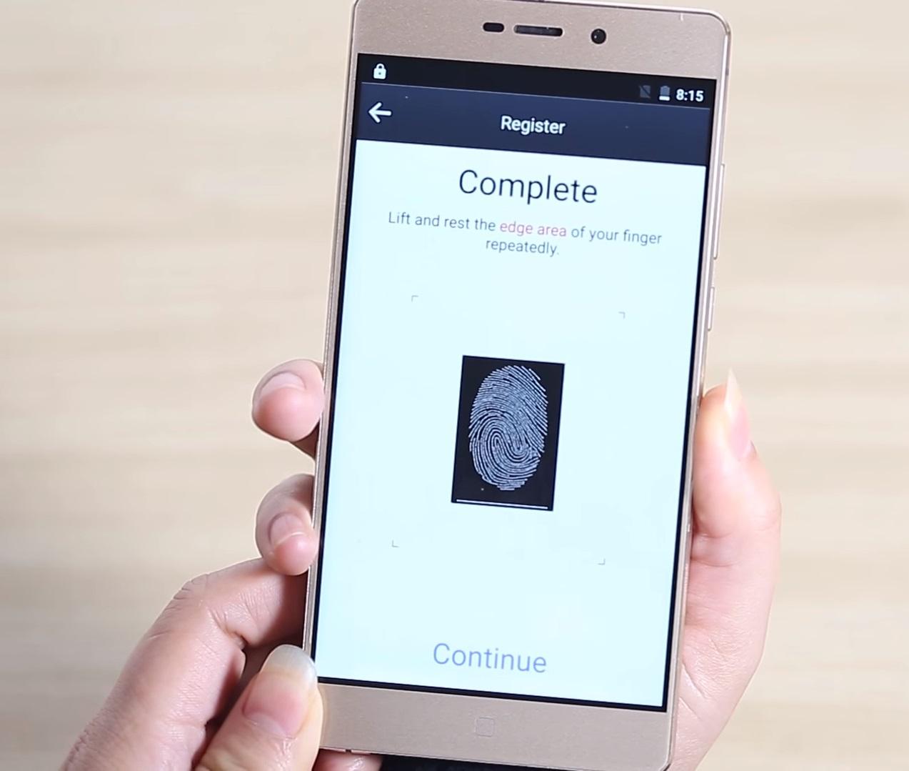 Elephone M3 held in hands, fingerptint scanner app showing.
