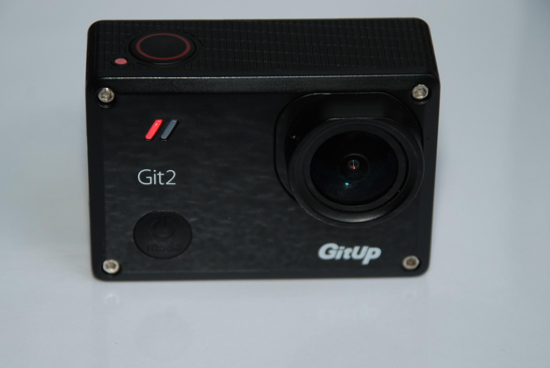 GitUp Git2 Pro Action Camera sitting on the white table.