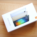 XiaoMi Redmi Note 3 Pro in a white box lying in a wooden table.