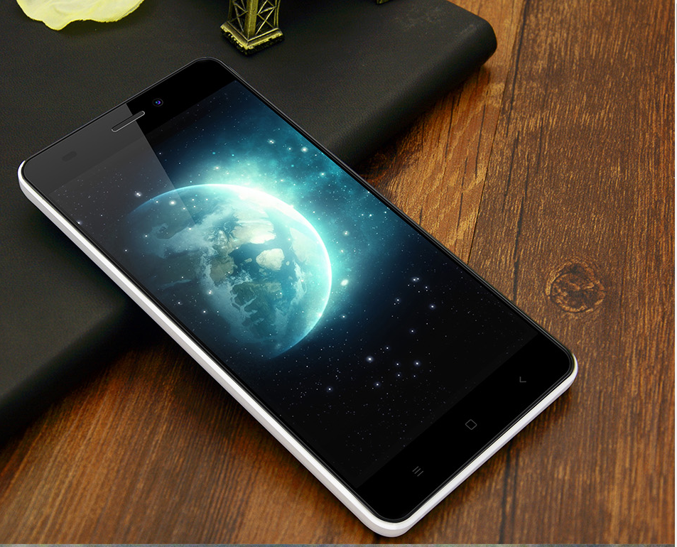 Oukitel C3 showing some planet on the display of the phone while it's lying on a wooden table.