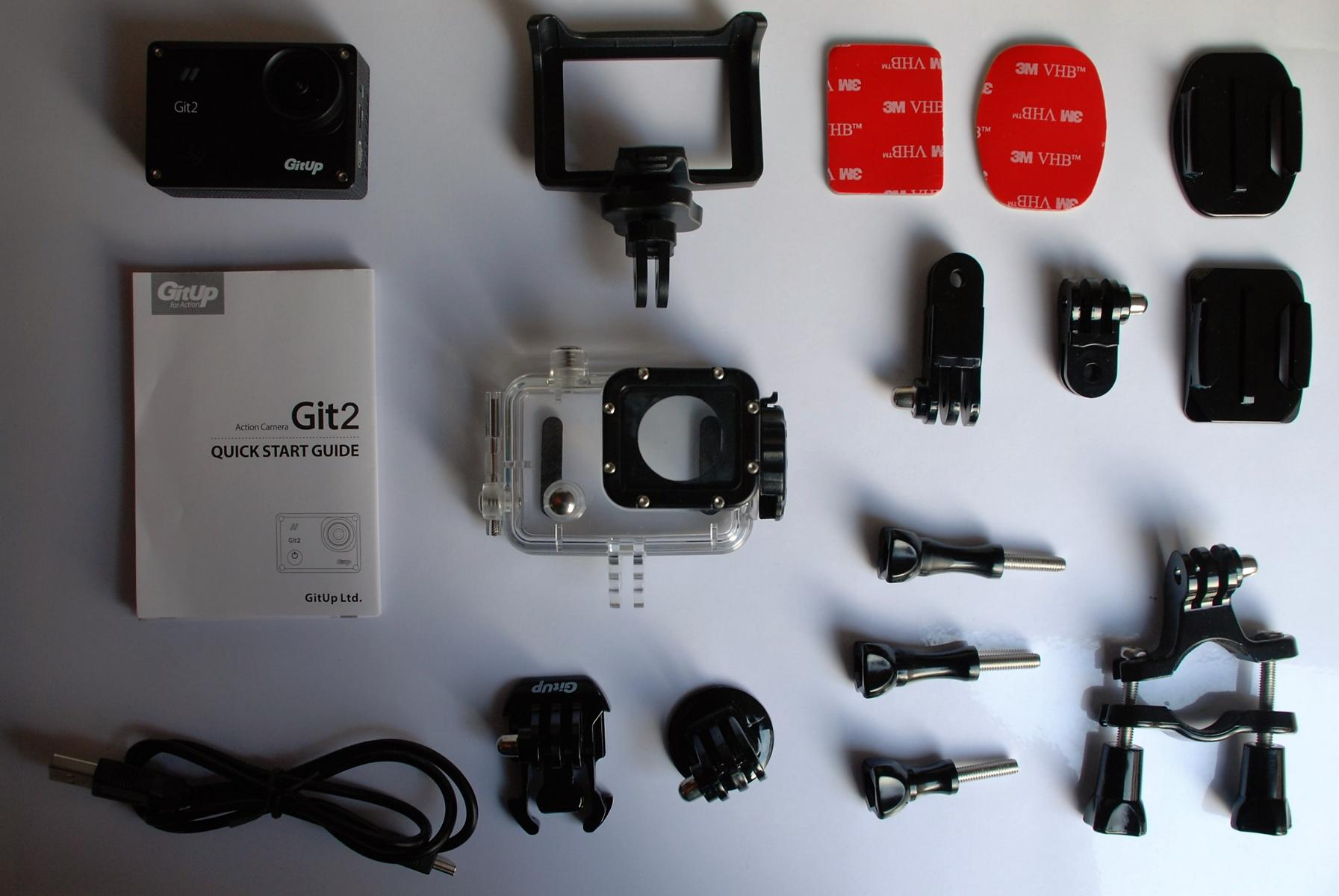 GitUp Git2 Pro Action Camera and additional accessories lying on a white table