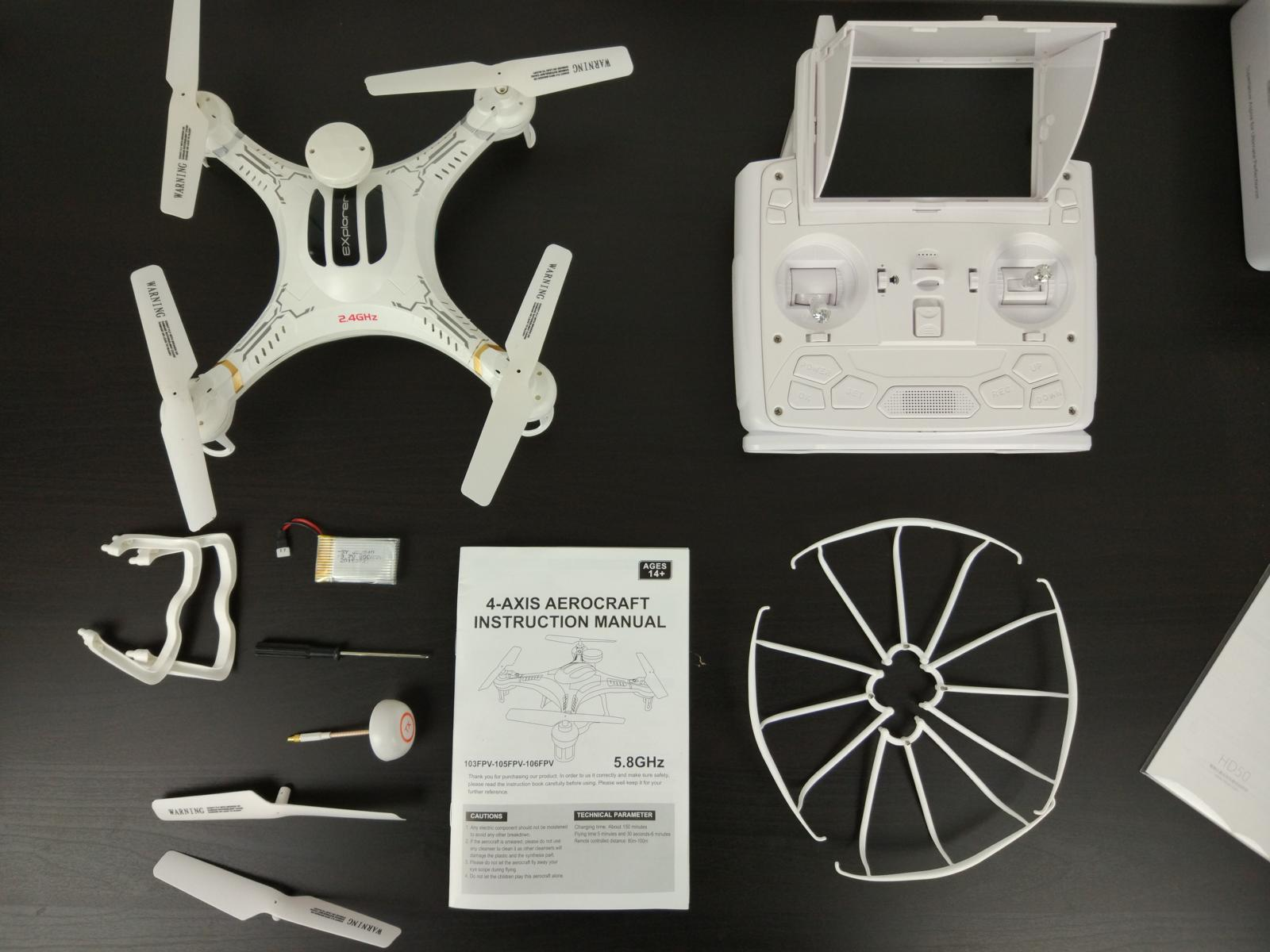 Xinlin X118 Quadcopter and additional equipment standing on the black table.