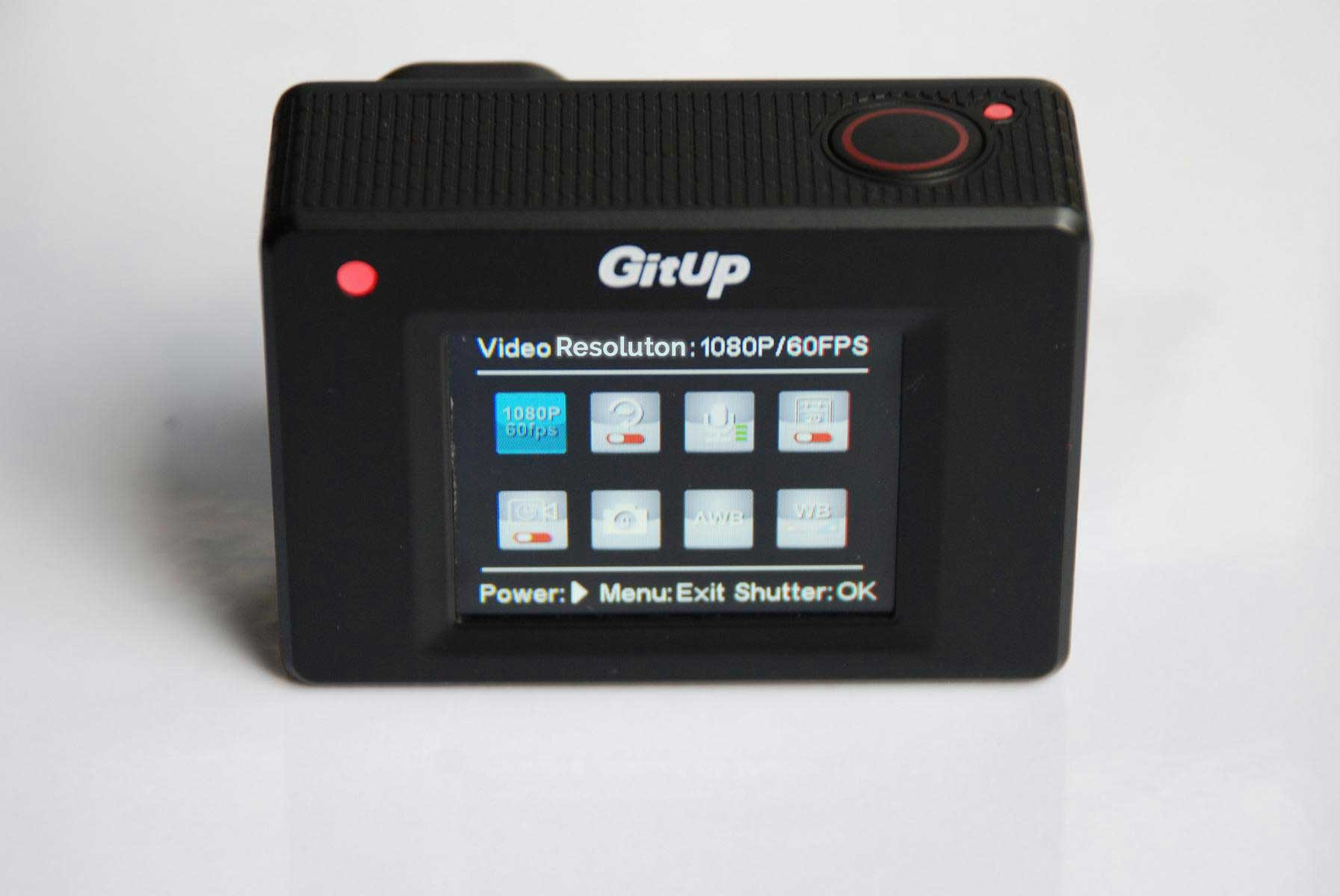 GitUp Git2 Pro Action Camera sitting on the white desk, display on