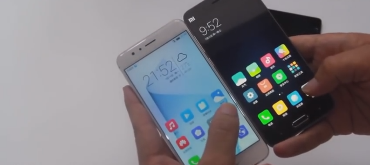 Holding Huawei Honor 8 and Xiaomi Mi5 in hand